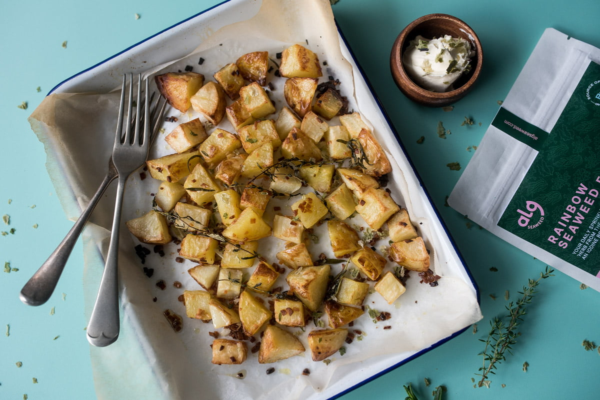 Roasted potato chunks with herbed garlic and seaweed, sour cream and packaging flatlay